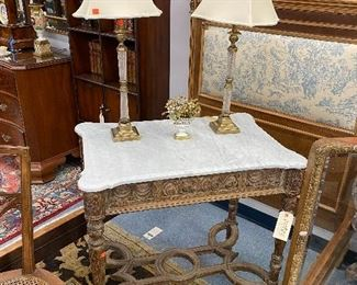 Carved wood table with marble top