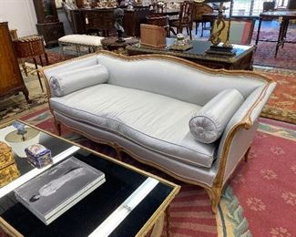 Beautiful French fruitwood sofa in a light blue upholstery.