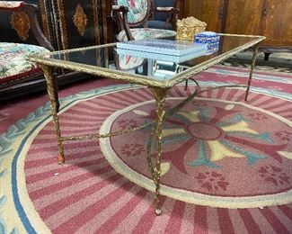 Stunning Hollywood Regency faux boi brass cocktail table.