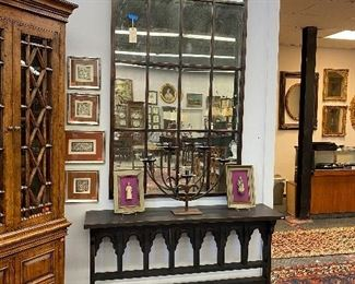 Large mirror by uttermost with distressed glass, Gothic style console table, five arm iron candelabra by Jan Barboglia