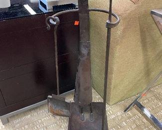 Modern primitive fireplace tool holder.