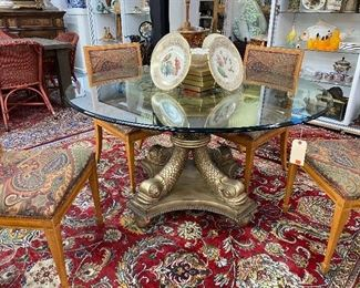 Stunning round foyer or dining glass top table with dolphin supports.