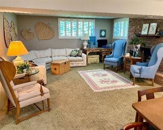 Lower level of house filled with furniture.