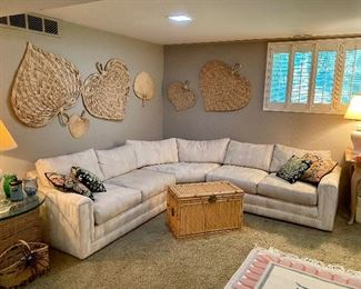 Neutral 3 piece sectional.  Nice wicker storage chest and natural fan wall art.