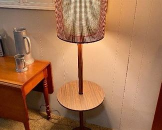 Mid century floor lamp with table.  Fiberglass inner shade woven wicker outer shade.
