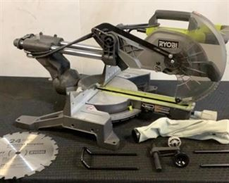 """Located in: Chattanooga, TN MFG Ryobi Model TSS103 Ser# GW20504D2B75070 Power (V-A-W-P) 120V - 60Hz - 15A 10"""" Miter Saw Tested Works 600 RPM **Sold As Is Where Is**"""