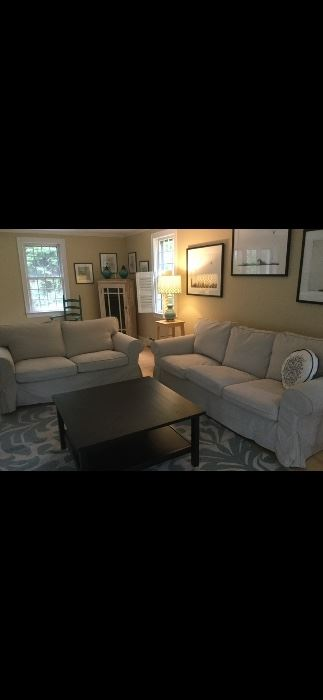 Sofas, coffee table and area rug. Tables and lamps.