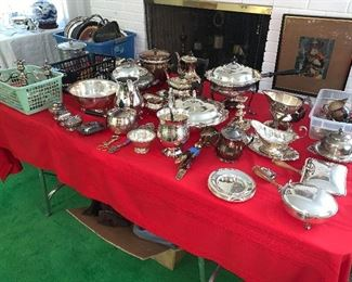 tables and bins full of silverplate