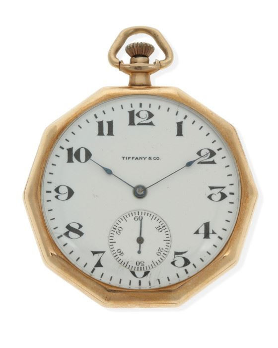 1001 A Gold Pocket Watch, Tiffany & Co Dial: White circular dial with black Arabic numerals, sub-seconds dial, signed Tiffany & Co. Movement:19J stemwind and set movement, jeweled gold chatons, nickel plated, damascened design, cut bi-metallic compensation balance, blued steel balance spring, jeweled straightline lever escapement, micrometric regulator, signed: Waltham / Mass. / Riverside, #23187356 Case: 14k yellow gold open face decagon shaped smooth polished case, signed: Wadsworth 14k Karat, #865767; with personalized engraved monogram 44 mm x 44 mm 59.3 grams Estimate: $600 - $800
