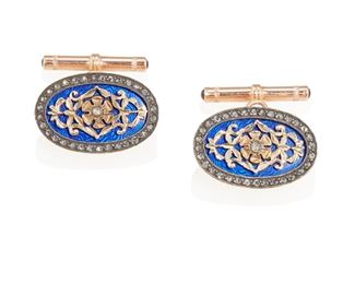 """1002 A Pair Of Russian Enamel And Diamond Cufflinks 18k rose gold and silver, marked to loop verso Each centering a yellow gold rosette in a blue enamel ground surrounded by rose-cut diamonds, with box Each: 1"""" H x .625"""" W 16.5 grams 2 pieces Estimate: $600 - $800"""