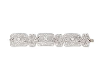 """1013 A Diamond Bracelet Circa 1950, platinum Centering upon three old European-cut diamonds, gauged at 2.00cts, 1.60cts, and 1.60cts and graded H-I color and SI clarity, further set with over three hundred seventy single and full-cut round diamonds, totaling approximately 15.00cts and graded G-H color and VS clarity 7.5"""" L x 1.4"""" H 88 grams Estimate: $25,000 - $30,000"""