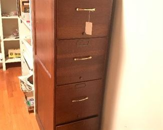 Wood sided file cabinet with metal drawers