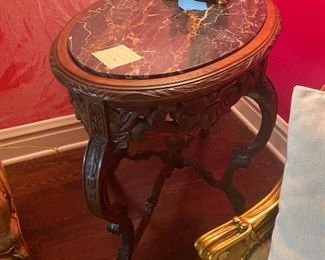 marble top end table, carved
