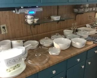 Lots of vintage corning ware dishes and refrigerator boxes