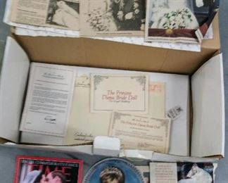 These are the extras, that come with the wonderful Princess Diana Bride Doll shown in another photo. Here, we have the box, papers, accessories, and complete magazines, about the great lady.