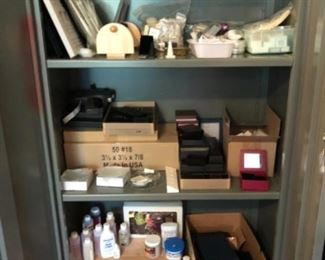 Gem and jewelry packaging and display. Some chemicals. Metal cabinet also for sale.