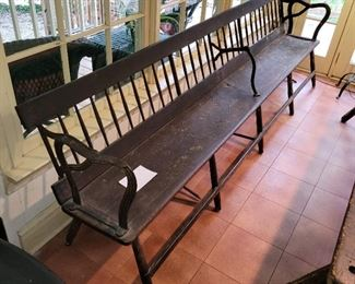 American 18th Century plank bottom bench, iron arms, reversible flip back