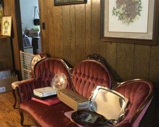Victorian style sofa.    Wildlife prints.