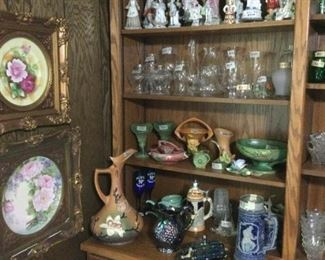 Roseville pottery.    Hand painted china plates in frames.    Porcelain figurines.