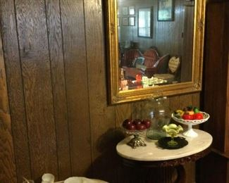 Marble top tables.    Large mirror.