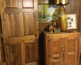 Antique ice box.     Amber bottle lamp.   Painting.