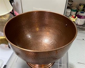 copper bowl for drinks has head of cows on each side