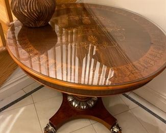 Neoclassical round table with glass top