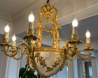 1910 Dining room chandelier from France Neoclassic french empire ornate gilded bronze and glass chandelier. Appraised at $10,000 in 2008. 34 inches wide. place of  origin: France.