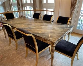 Dining room table  by John Richards fine furnisher 96 inches long and 48 inches deep with  brown marble top