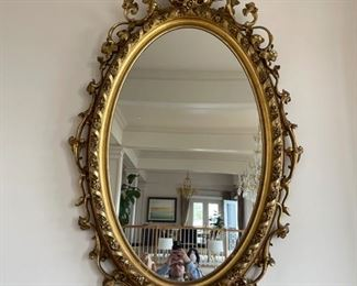 Large mirror 92 x 40 inches long Giltwood and Plaster oval wall mirror 19th Century elaborate scrollwork with garland designed bezel and pierced figural crest having a scrolled acanthus leaf network encircling the frame. Appraised at $16,000 in 2008. Mirror is from James S Earle Galleries