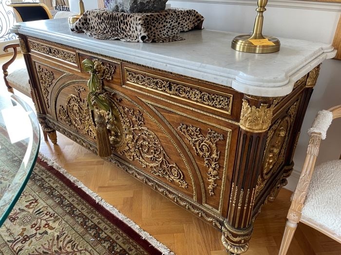 An Amazing piece Marie Antoinette Salon  piece 3 draws over 2 doors base gilt metal dials on front and sides of nudes and putti figurines and lion head Escutcheon cabinet  71 inches x 26 deep and 37 inches high. Model by Joseph Stockel & Guilaume Bemmeman.