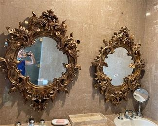 two ornate mirrors