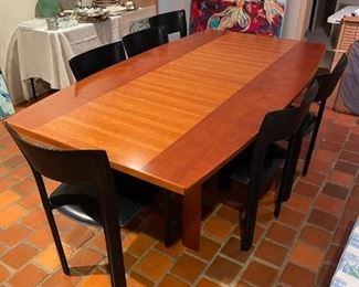 Swedish inspired table with six leather chairs