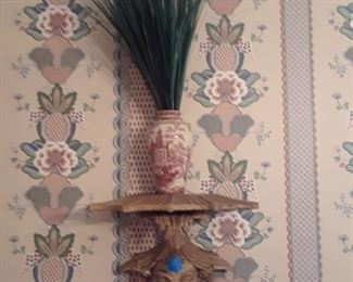 Red transferware vase on Chinese figural sconce