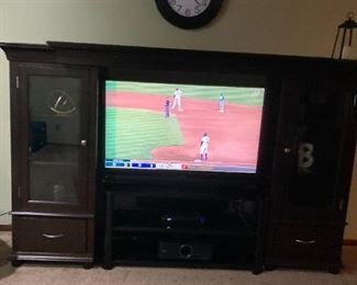 . . . a nice large flat-screen TV in beautiful cabinet