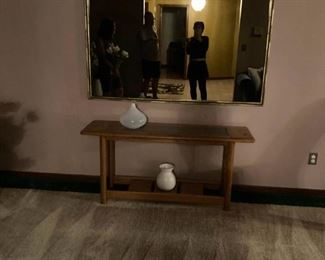 . . . a nice accent mirror above wall/sofa table with nice white accent vases