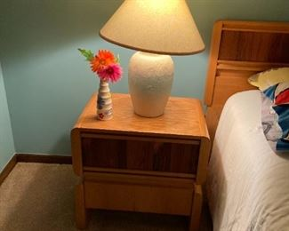 . . . love this cute mid-century nightstand that finishes off the bedroom set