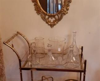 Oval mirror, glass/brass cart, decanters