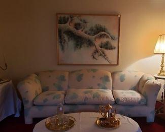 Aqua blue cream sofa, art, lamp