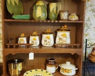 Maple hutch with Shawnee corn pottery, mushroom canisters