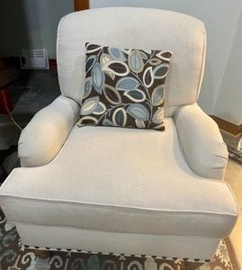 This Cambridge Collection chair is upholstered in a luxurious ivory fabric accented with studded detailing.  The neutral fabric would match an home decor and provides a nice clean, classic look. Sold in very good condition with light wear and measures 32x38x38 inches.