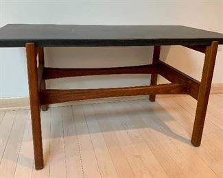 """Jens Rison Design Mid Century Table. Features a walnut base and slate top. Circa 1960's   Measures 36"""" x 17"""" x 18"""" In very good condition with overall light wear."""