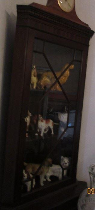 display cupboard and dog ceramics