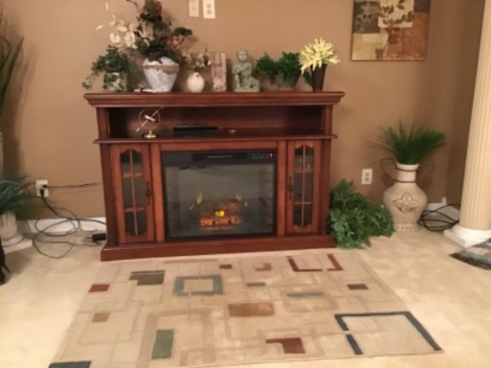 Very nice fireplace/TV cabinet in working condition