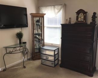 Very nice chest, glass top table , small curio cabinet and wall flat screen