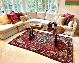 Antique wishbone coffee table, Persian rugs, custom pillows, and more. Sectional has been sold.