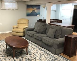 couch, coffee table and manual recliner