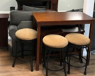 small table, swivel bar stools