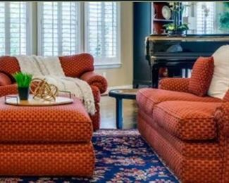 Red fabric overstuffed love seat and lounger chair, ottoman