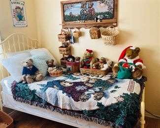 Metal twin bed with mattress and box springs, baskets, Boyd's bears